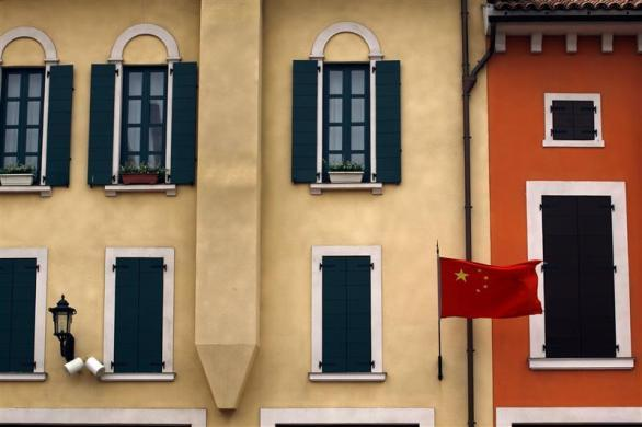A Chinese national flag flies from buildings resembling those found in an Italian town at the Florentia Village in the district of Wuqing, located on the outskirts of the city of Tianjin June 13, 2012.