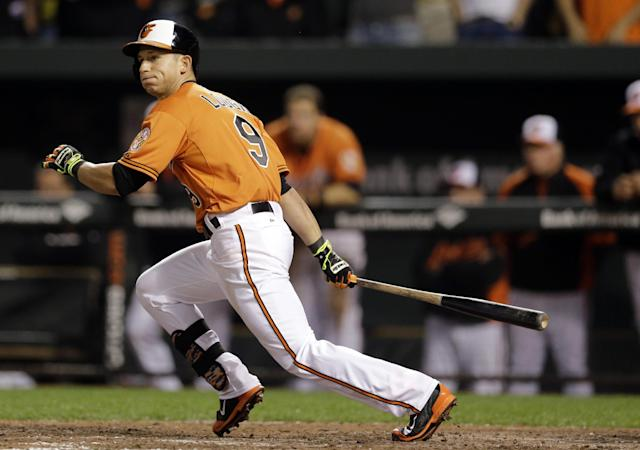 Baltimore Orioles' David Lough watches his single in the 12th inning of a baseball game against the Toronto Blue Jays, Saturday, April 12, 2014, in Baltimore. Stephen Lombardozzi scored on the play, and Baltimore won 2-1. (AP Photo/Patrick Semansky)