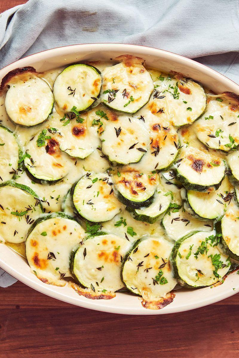 """<p>A little lighter than your average gratin.</p><p>Get the <a href=""""https://www.delish.com/uk/cooking/recipes/a30238594/cheesy-scalloped-zucchini-recipe/"""" rel=""""nofollow noopener"""" target=""""_blank"""" data-ylk=""""slk:Cheesy Scalloped Courgette"""" class=""""link rapid-noclick-resp"""">Cheesy Scalloped Courgette</a> recipe.</p>"""