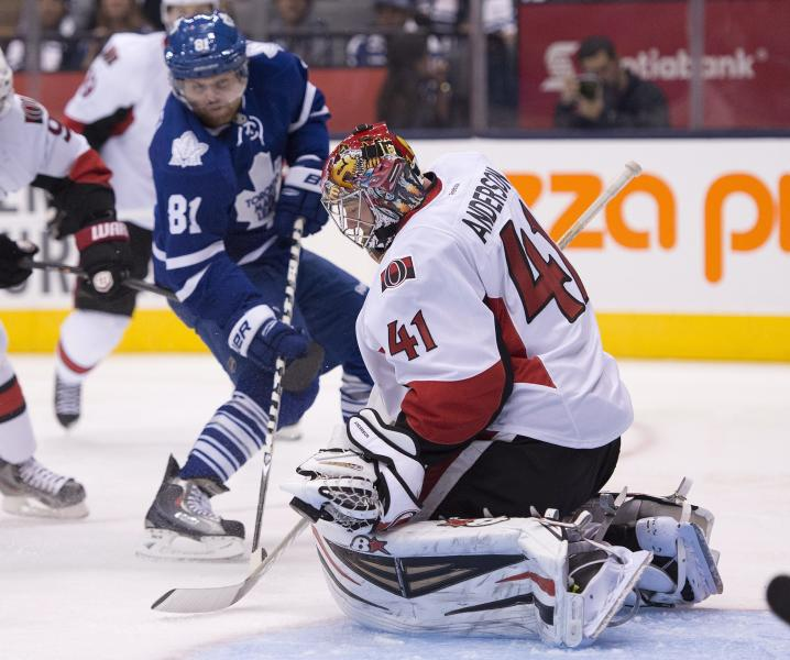 Ottawa Senators goaltender Craig Anderson (41) makes a save against Toronto Maple Leafs' Phil Kessel (81) during second-period NHL hockey game action in Toronto, Saturday, Oct. 5, 2013. (AP Photo/The Canadian Press, Frank Gunn)