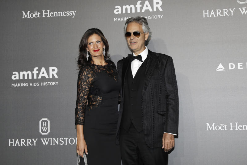 Andrea Bocelli, right, poses with his wife Veronica Berti as they arrive for the amfAR charity dinner during the fashion week in Milan, Italy, Thursday, Sept. 21, 2017. (AP Photo/Antonio Calanni)