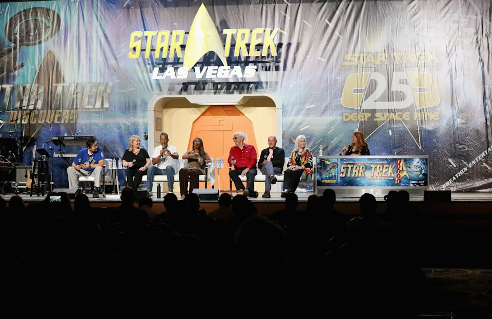 Nathan Jung, with actress Kellie Flanagan, actor Phil Morris, actress Iona Morris, actor Michael Forest, actor and stuntman Phil Adams, actress Celeste Yarnall and actress at the official Star Trek convention. Photo: Getty