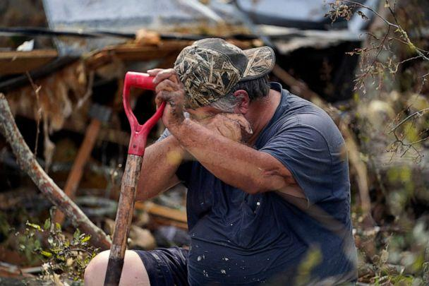 PHOTO: Bradley Beard rests next to his heavily damaged home in the aftermath of Hurricane Laura in Hackberry, La., Aug. 29, 2020. (Gerald Herbert/AP, FILE)