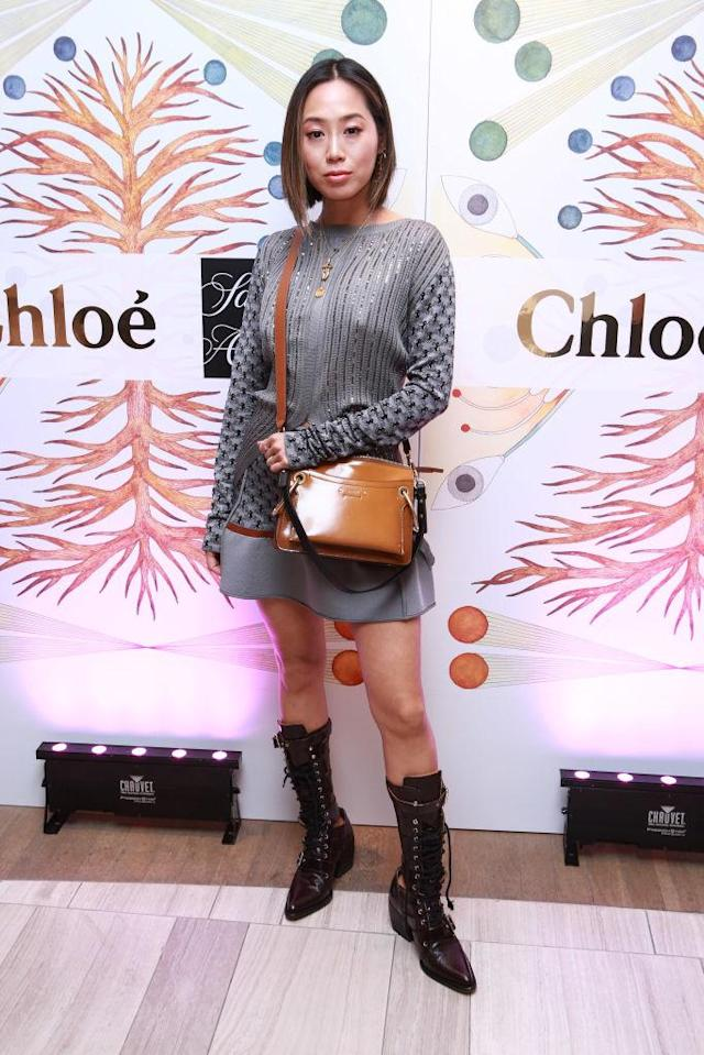 <p>Song kept her legs exposed in a mini dress and a pair of cut-out boots. (Photo: Getty Images) </p>