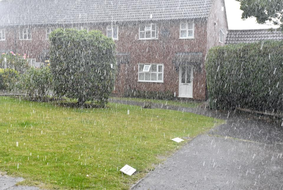 Heavy rain in Billericay, Essex during a brief but heavy storm. A yellow warning for storms has been issued by the Met Office for parts of the East Midlands, South East and East of England from 1pm on Tuesday until the end of the day. Picture date: Tuesday July 20, 2021.