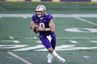 Washington quarterback Dylan Morris scrambles against Stanford in the first half of an NCAA college football game Saturday, Dec. 5, 2020, in Seattle. (AP Photo/Elaine Thompson)