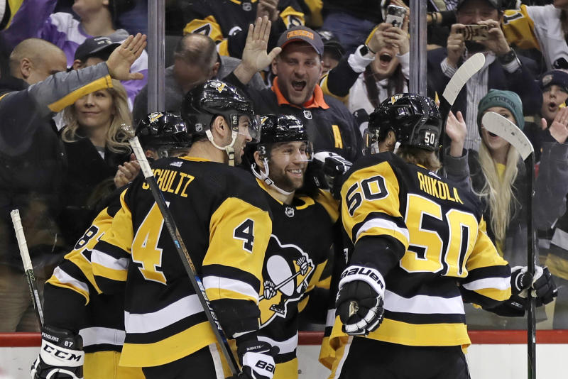 Pittsburgh Penguins' Jason Zucker, center, celebrates his goal during the second period of the team's NHL hockey game against the Montreal Canadiens in Pittsburgh, Friday, Feb. 14, 2020. (AP Photo/Gene J. Puskar)
