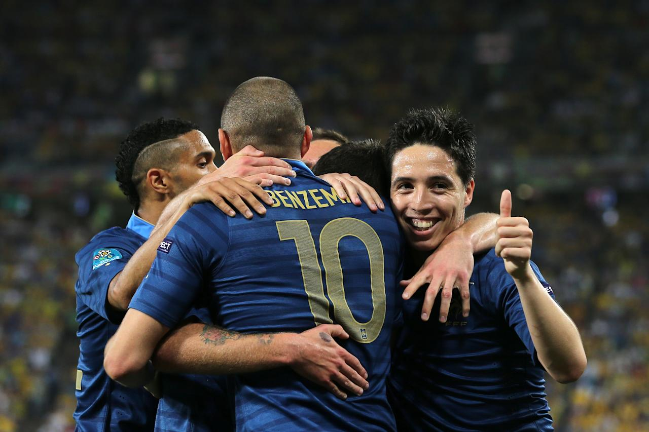 DONETSK, UKRAINE - JUNE 15: Samir Nasri of France (R) gives the thumbs up as he celebrates Jeremy Menez of France scoring the first goal  during the UEFA EURO 2012 group D match between Ukraine and France at Donbass Arena on June 15, 2012 in Donetsk, Ukraine.  (Photo by Ian Walton/Getty Images)