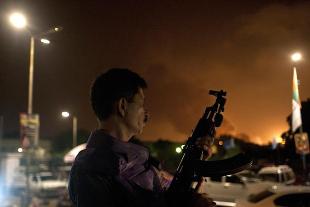 <p>A Pakistani soldier takes position at Jinnah International Airport where security forces are fighting with gunmen who disguised themselves as police guards and stormed a terminal used for VIPs and cargo, June 8, 2014, in Pakistan. (AP Photo/Shakil Adil) </p>