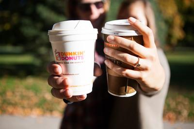 Dunkin' Donuts celebrates Valentine's Day with a full schedule of social programming: chance to win a year's worth of coffee and donuts with #DunkinLoveContest on Instagram, a Facebook Live musical performance with Us The Duo, an iMessage custom card builder, the launch of an emoji keyboard and new Snapchat geofilters. Pictured: Olivia and Rob, a young couple from Missouri whose love story involved Dunkin' Donuts from their first date to their wedding.