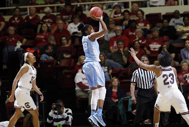 North Carolina guard Diamond DeShields (23) shoots between South Carolina's Asia Dozier, left, and Tina Roy (23) during the first half of a regional semifinal at the NCAA college basketball tournament in Stanford, Calif., Sunday, March 30, 2014. (AP Photo/Marcio Jose Sanchez)