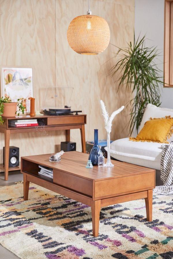 """<p>The midcentury modern style of this <a href=""""https://www.popsugar.com/buy/Dexter-Coffee-Table-482296?p_name=Dexter%20Coffee%20Table&retailer=urbanoutfitters.com&pid=482296&price=399&evar1=casa%3Auk&evar9=46520015&evar98=https%3A%2F%2Fwww.popsugar.com%2Fhome%2Fphoto-gallery%2F46520015%2Fimage%2F46520452%2FDexter-Coffee-Table&list1=shopping%2Cfurniture%2Csmall%20space%20living%2Cliving%20rooms%2Chome%20shopping&prop13=api&pdata=1"""" rel=""""nofollow"""" data-shoppable-link=""""1"""" target=""""_blank"""" class=""""ga-track"""" data-ga-category=""""Related"""" data-ga-label=""""https://www.urbanoutfitters.com/shop/dexter-coffee-table?category=SEARCHRESULTS&amp;color=020"""" data-ga-action=""""In-Line Links"""">Dexter Coffee Table</a> ($399) sold us.</p>"""