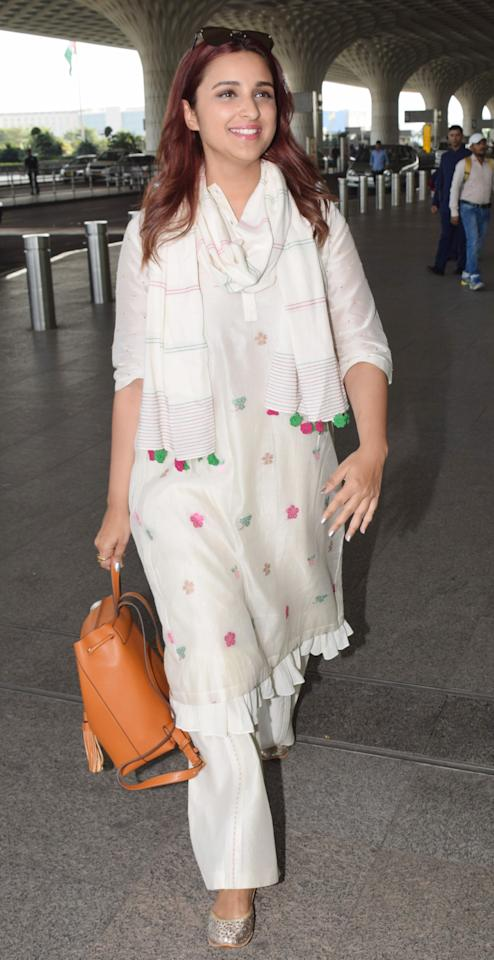 <p>Parineeti mixes different shades of white with a hit of colour as prints to create a stylish emsemble. </p>