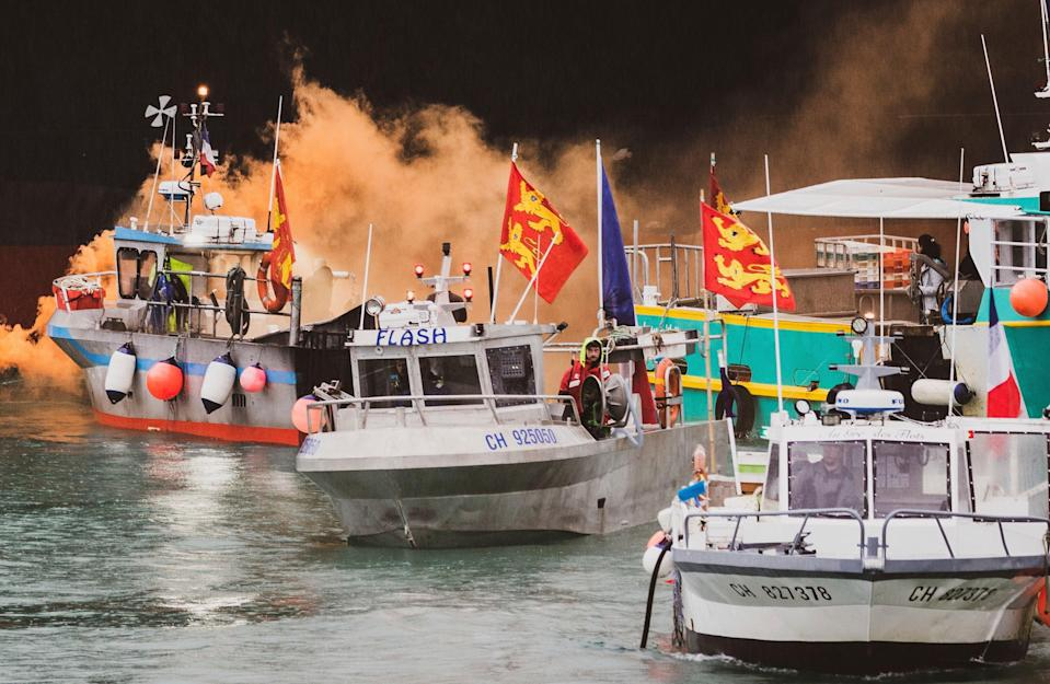 <p>French fishing vessels at sea off the coast of Jersey during a protest last week</p> (AP)
