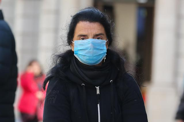 A woman in central London wears a face mask as a precaution against the spread of coronavirus. (Steve Taylor/SOPA Images/LightRocket via Getty Images)