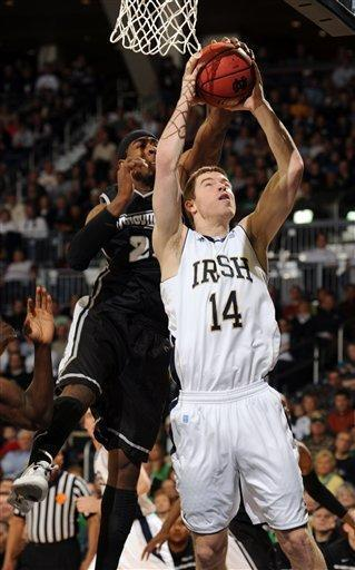 Notre Dame forward Scott Martin, right, puts up a shot as Providence forward LaDontae Henton defends in the first half of an NCAA college basketball game Friday, March 2, 2012, in South Bend, Ind. (AP Photo/Joe Raymond)