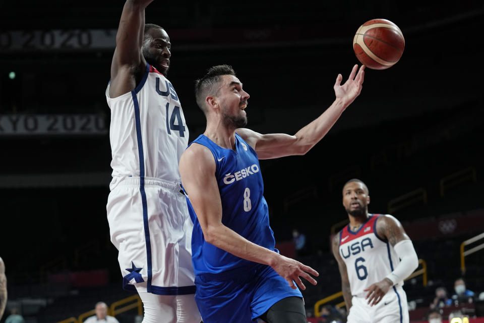 Czech Republic's Tomas Satoransky (8) drives to the basket against United States's Draymond Green (14) during a men's basketball preliminary round game at the 2020 Summer Olympics, Saturday, July 31, 2021, in Saitama, Japan. (AP Photo/Eric Gay)