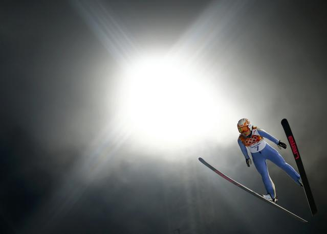 Canada's Atsuko Tanaka soars through the air in her trial jump during the women's ski jumping individual normal hill event of the Sochi 2014 Winter Olympic Games, at the RusSki Gorki Ski Jumping Center in Rosa Khutor, February 11, 2014. REUTERS/Kai Pfaffenbach (RUSSIA - Tags: OLYMPICS SPORT SKIING)