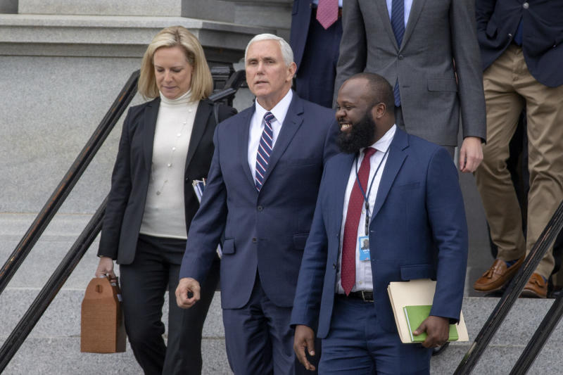 WASHINGTON, DC - JANUARY 05: (AFP OUT) (L-R) Secretary of Homeland Security Kirstjen Nielsen, Vice President Mike Pence and Ja'Ron Smith special assistant to the President of the United States exit the Eisenhower Executive Office Building on January 05, 2019 in Washington, DC. The U.S government is going into the third week of a partial shutdown with Republicans and Democrats at odds on agreeing with President Donald Trump's demands for more money to build a wall along the U.S.-Mexico border. (Photo by Tasos Katopodis/Getty Images)