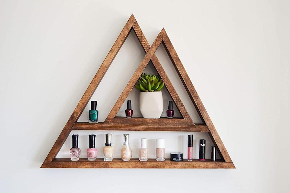 <p>The <span>Two Peak Mountain Wood Floating Display Shelf</span> ($60) doubles as decor and storage, it's the best of both worlds.</p>