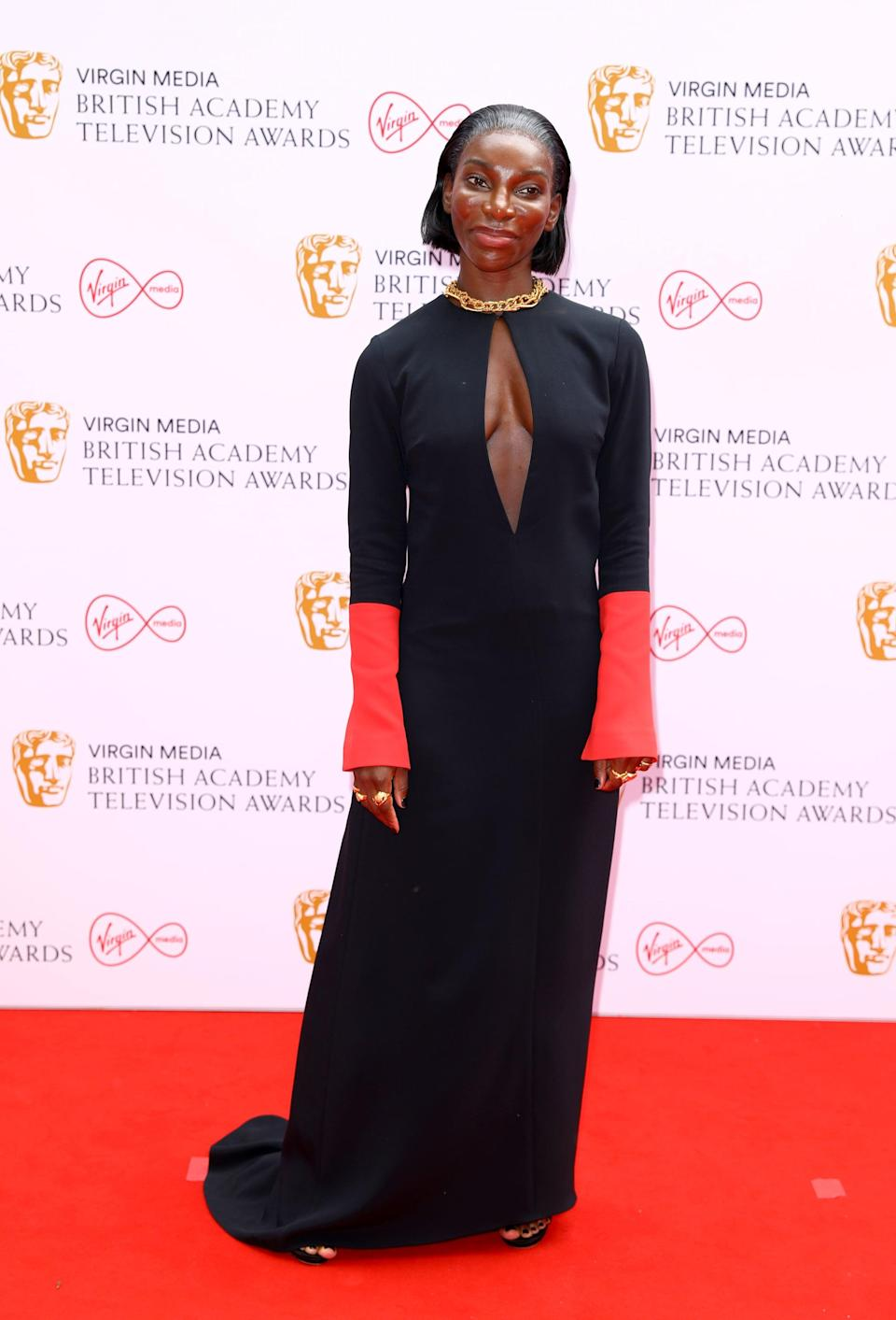 <p>Michaela Coel wore a black-and-red custom Highway gown by Maximilian.</p>