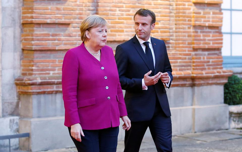 French President Emmanuel Macron and German Chancellor Angela Merkel welcome European Commission president-elect Ursula Von der Leyen (not pictured) after a joint Franco-German cabinet meeting in Toulouse, France, October 16, 2019. REUTERS/Regis Duvignau