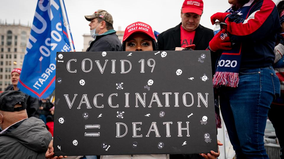 A supporter of President Donald Trump on Jan. 5 holds an anti-vaccine sign at a protest at Freedom Plaza in Washington, D.C.