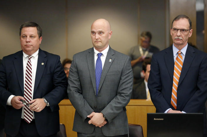 Fired Balch Springs police officer Roy Oliver, center, and his attorneys Miles Brissette, left, and Bob Gill stand before the reading of the verdict during Oliver's trial at the Frank Crowley Courts Building in Dallas on Tuesday, Aug. 28, 2018. Oliver was convicted of murder on Tuesday for fatally shooting an unarmed black teenager when he fired into a car full of teenagers leaving a house party in suburban Dallas. (Rose Baca/The Dallas Morning News via AP, Pool)