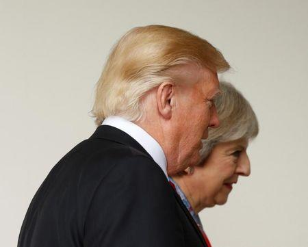 File photo: U.S. President Donald Trump walks with British Prime Minister Theresa May after their meeting at the White House in Washington, U.S., January 27, 2017. REUTERS/Kevin Lamarque