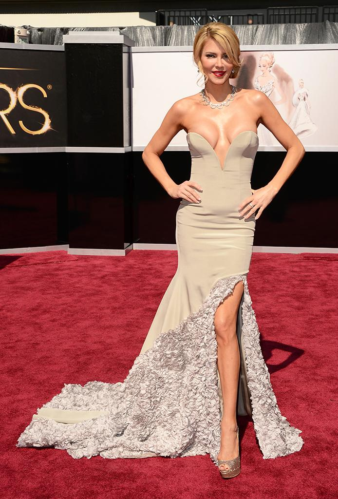 """Worst: You can take the housewife out of Beverly Hills, but you can't take the Beverly Hills out of the housewife. Brandi Glanville's dress made everyone a little nervous that one deep breath would create a wardrobe malfunction. People may say """"if you've got it, flaunt it,"""" but they don't mean all of it at the same time."""
