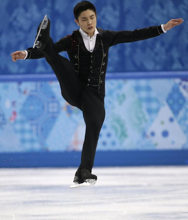 Yan Han of China competes in the men's free skate figure skating final at the Iceberg Skating Palace during the 2014 Winter Olympics, Friday, Feb. 14, 2014, in Sochi, Russia