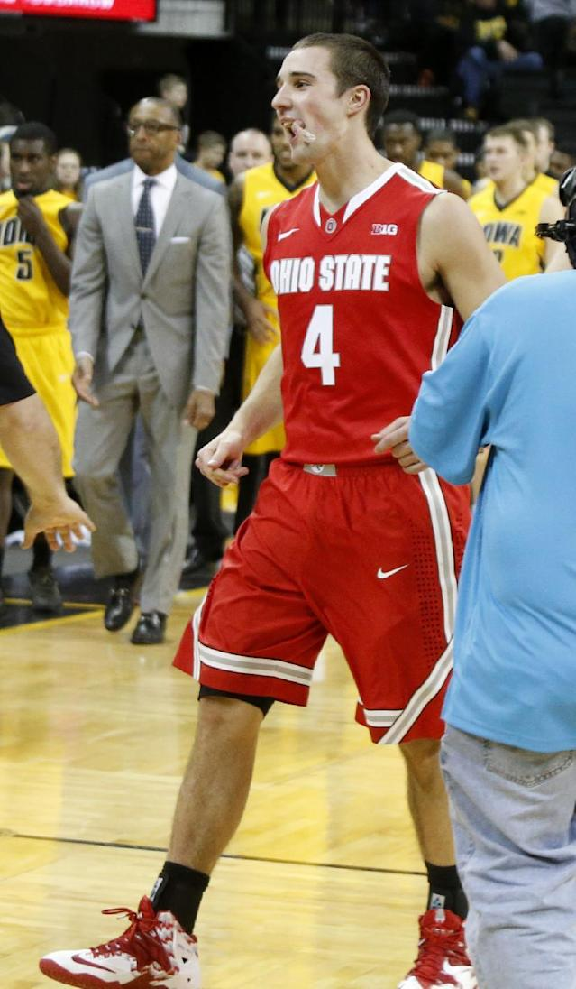 Ohio State's Aaron Craft (4) celebrates after Ohio State's 76-69 victory over Iowa in an NCAA college basketball game at Carver-Hawkeye Arena in Iowa City, Iowa, on Tuesday, Feb. 4, 2014. (AP Photo/Cliff Jette)