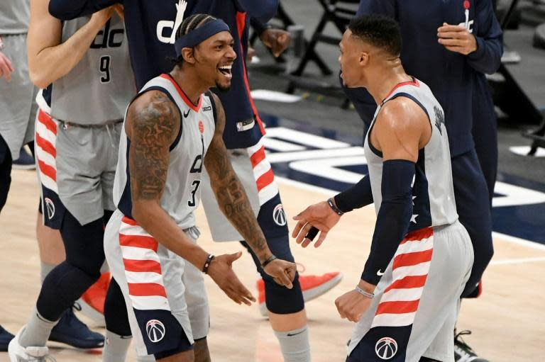 Russell Westbrook (R) and Bradley Beal celebrate the Washington Wizards' 149-146 NBA victory over the Brooklyn Nets