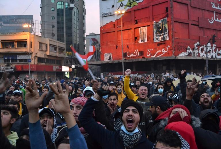 Lebanese protesters vent their anger by shouting slogans at Tripoli's Al-Nour Square, the scene of mass protests against the political class that began in late 2019