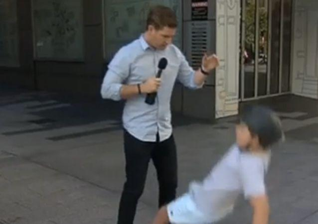 Charlie tumbles to the ground, after Sam pats him on the back. Source: Sunrise.