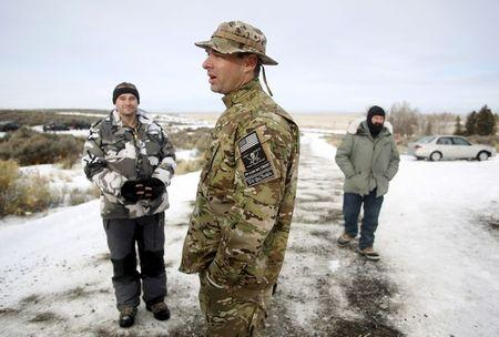 Militiamen stand on a road at the Malheur National Wildlife Refuge near Burns, Oregon, January 4, 2016. REUTERS/Jim Urquhart/File Photo