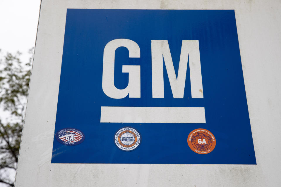 FILE - This Oct. 16, 2019, file photo shows a sign at a General Motors facility in Langhorne, Pa. On Thursday, Nov. 19, 2020, General Motors says a pending breakthrough in battery chemistry will cut the price of its electric vehicles so they equal those powered by gasoline within five years. (AP Photo/Matt Rourke, File)