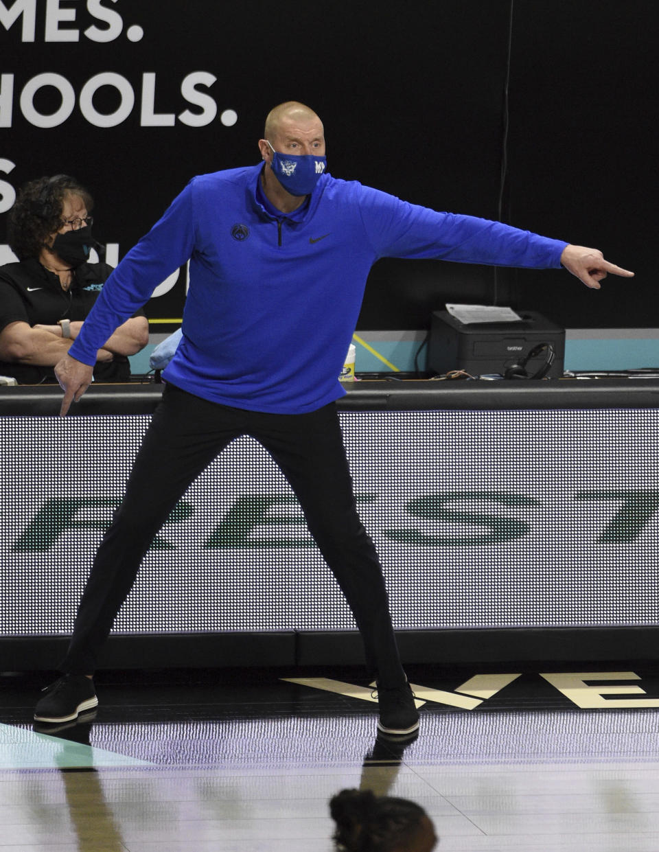 BYU coach Mark Pope calls to the team during the first half of NCAA college basketball game against Gonzaga for the West Coast Conference men's tournament championship Tuesday, March 9, 2021, in Las Vegas. (AP Photo/David Becker)