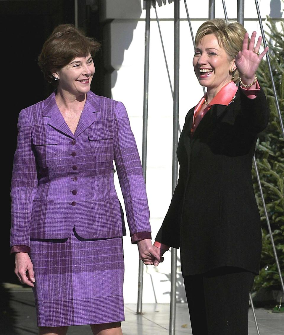 First lady Hillary Clinton waves as she greets incoming first lady Laura Bush Dec. 18, 2000 at the White House.
