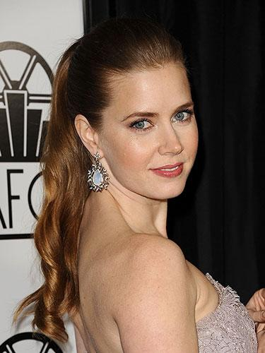 "<div class=""caption-credit""> Photo by: Jason LaVeris</div><div class=""caption-title"">Amy Adams</div>A ponytail suddenly becomes flirty when set on the crown with loose, romantic waves. <br> <br> <b>More from REDBOOK: <br></b> <ul>  <li>  <a rel=""nofollow"" target="""" href=""http://www.redbookmag.com/beauty-fashion/tips-advice/celebrity-hair-how-to?link=rel&dom=yah_life&src=syn&con=blog_redbook&mag=rbk""><b>100 Hot Celebrity Hairstyles For Every Hair Type</b></a>  </li>  <li>  <a rel=""nofollow"" target="""" href=""http://www.redbookmag.com/beauty-fashion/tips-advice/work-wear?link=rel&dom=yah_life&src=syn&con=blog_redbook&mag=rbk""><b>The Most Iconic Workwear of All Time</b></a>  </li> </ul>"