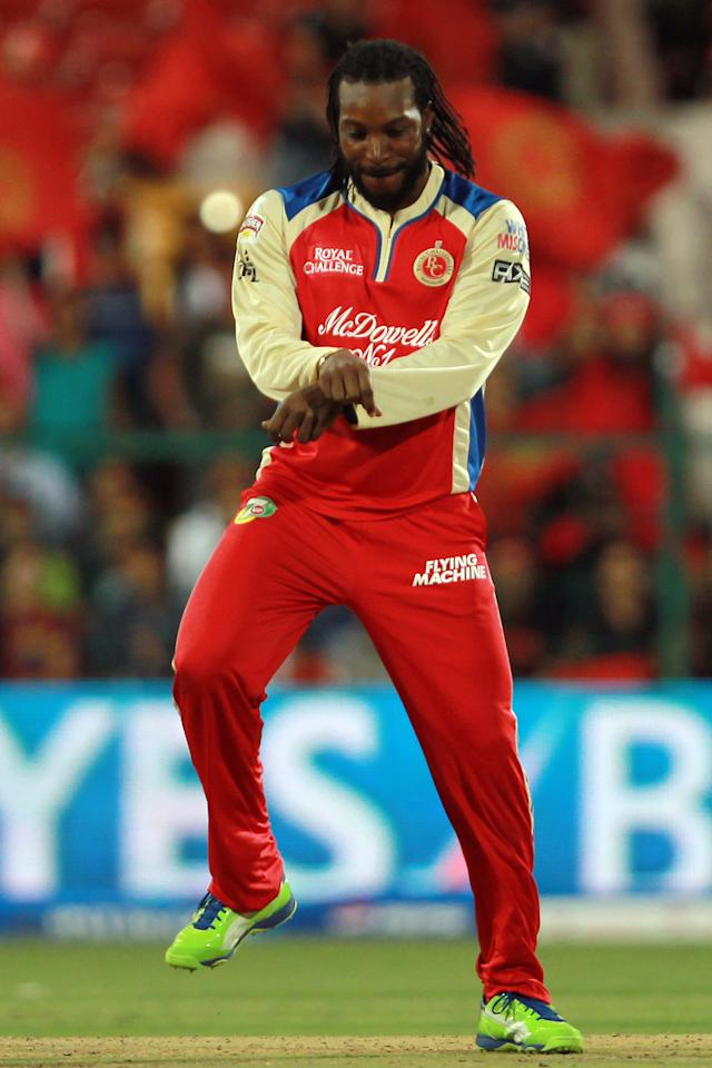 Chris Gayle celebrates his record-breaking innings of 175 not out and 2 wickets in a single over Gangnam Style during match 31 of the Pepsi Indian Premier League between The Royal Challengers Bangalore and The Pune Warriors India held at the M. Chinnaswamy Stadium, Bengaluru  on the 23rd April 2013. Photo by Jacques Rossouw-IPL-SPORTZPICS   ..Use of this image is subject to the terms and conditions as outlined by the BCCI. These terms can be found by following this link:..https://ec.yimg.com/ec?url=http%3a%2f%2fwww.sportzpics.co.za%2fimage%2fI0000SoRagM2cIEc&t=1490668412&sig=C.xjsVqTV8kpRCE_5S.e9g--~C