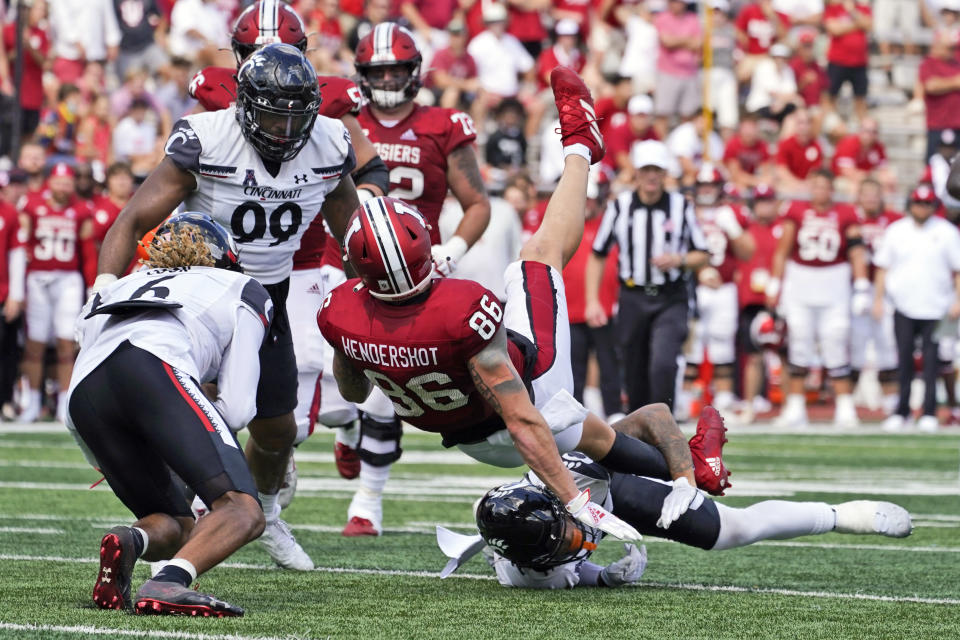 Indiana's Peyton Hendershot (86) is tackled Cincinnati's Deshawn Pace (20) during the first half of an NCAA college football game, Saturday, Sept. 18, 2021, in Bloomington, Ind. (AP Photo/Darron Cummings)