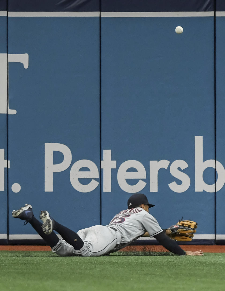 The ball bounces past Cleveland Indians left fielder Oscar Mercado as he dives for a double hit by Tampa Bay Rays' Francisco Mejia during the second inning in the second baseball game of a doubleheader Wednesday, July 7, 2021, in St. Petersburg, Fla.(AP Photo/Steve Nesius)