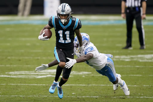 Carolina Panthers wide receiver Robby Anderson breaks away from Detroit Lions' Jayron Kearse during the second half of an NFL football game Sunday, Nov. 22, 2020, in Charlotte, N.C. (AP Photo/Brian Blanco)