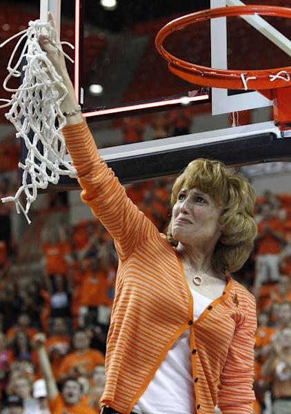 Shelley Budke, the widow of Kurt Budke, the Oklahoma State women's basketball coach who died in a plane crash in November of 2011, looks to the sky and raises the net after Oklahoma State defeated James Madison 75-68 in the WNIT Championship basketball game in Stillwater, Okla., Saturday, March 31, 2012. (AP Photo/Sue Ogrocki)