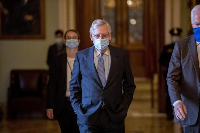 Senate Majority Leader Mitch McConnell of Ky., walks to his office after leaving the Senate floor on Capitol Hill, Wednesday, June 17, 2020, in Washington. (AP Photo/Andrew Harnik)