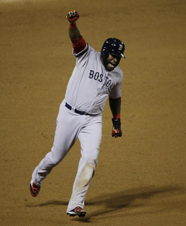 Boston Red Sox David Ortiz celebrates Jonny Gomes' three run home run off of St. Louis Cardinals relief pitcher Seth Maness as he scores during the sixth inning of Game 4 of baseball's World Series Sunday, Oct. 27, 2013, in St. Louis. (AP Photo/Charlie Neibergall)