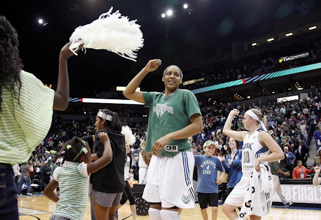 Minnesota Lynx forward Maya Moore, center, celebrates with fans on the court after her team's 84-59 win against the Atlanta Dream in Game 1 of the WNBA basketball finals, Sunday, Oct. 6, 2013, in Minneapolis. The Lynx won 84-59. (AP Photo/Stacy Bengs)