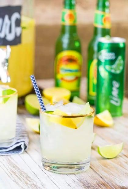 """<p>Meet the drink all of your friends are going to ask you to make for their Summer parties: <a href=""""https://www.thecookierookie.com/ginger-beer-party-punch/#sthash.SCQc2NJa.dpuf"""" target=""""_blank"""" class=""""ga-track"""" data-ga-category=""""Related"""" data-ga-label=""""https://www.thecookierookie.com/ginger-beer-party-punch/#sthash.SCQc2NJa.dpuf"""" data-ga-action=""""In-Line Links"""">ginger beer party punch</a>. Made with lemonade, Bud Light Lime, Ginger Beer, and lime and lemon slices for garnish, this is sweet, refreshing, and supereasy to <a class=""""sugar-inline-link ga-track"""" title=""""Latest photos and news for DIY"""" href=""""https://www.popsugar.com/DIY"""" target=""""_blank"""" data-ga-category=""""Related"""" data-ga-label=""""https://www.popsugar.com/DIY"""" data-ga-action=""""&lt;-related-&gt; Links"""">DIY</a>.</p>"""