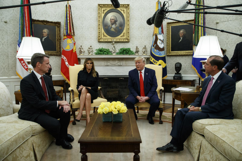 President Donald Trump talks about a plan to ban most flavored e-cigarettes, in the Oval Office of the White House, Wednesday, Sept. 11, 2019, in Washington. From left, acting FDA Commissioner Ned Sharpless, first lady Melania Trump, Trump, and Secretary of Health and Human Services Alex Azar. (AP Photo/Evan Vucci)
